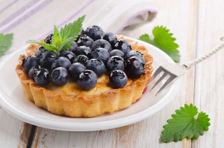 Fresh Blueberry tart on a white plate. Selective focus photo