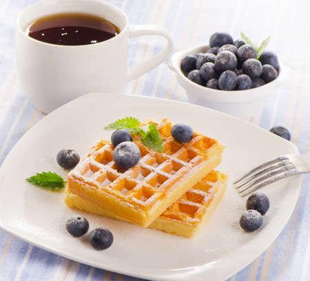 Breakfast - Belgian waffles with tea cup. Selective focus photo