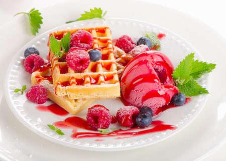 Belgian waffles with raspberries sorbet. Selective focus photo