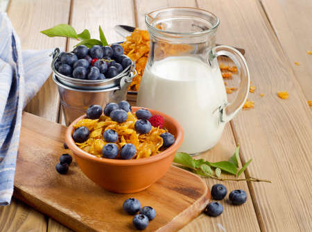 Healthy breakfast - Corn flakes with fresh blueberries and milk. Selective focus photo
