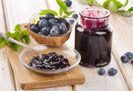 Fresh blueberries jam in a glass  jar. Selective focus photo