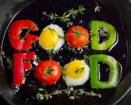 Fried vegetables and eggs with herbs  in pan  photo