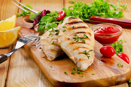 Grilled chicken breast with fresh vegetables . Selective focus Stock Photo