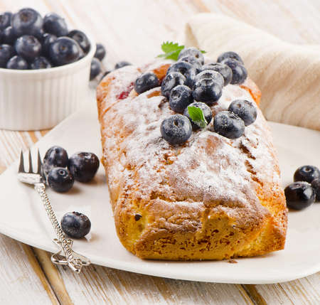 Delicious homemade blueberry cake with fresh blueberries . Selective focus photo