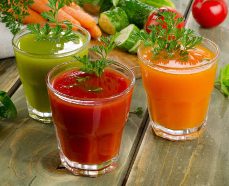 Healthy vegetable  juices on a wooden table. Selective focus photo