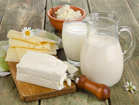 Fresh milk and dairy products on a wooden table. Selective focus Foto de archivo