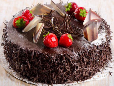 Sweet chocolate cake with strawberries. Selective focus photo