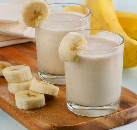 Two glasses of Banana smoothie . Selective focus photo
