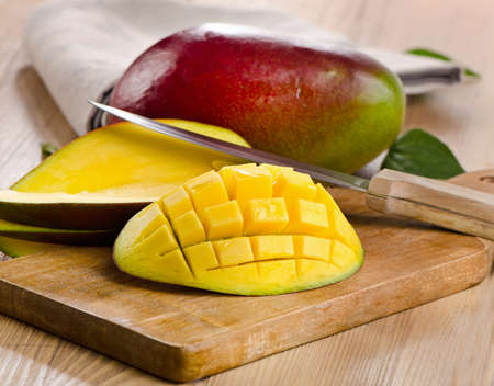 Fresh mango on a wooden board. Selective focus photo