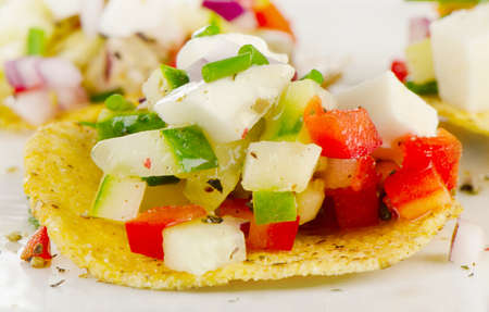 corn chip: Corn nachos with vegetables and feta. Selective focus
