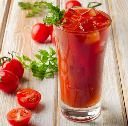 bloody  mary: Bloody Mary Alcoholic  cocktail  with ripe   tomatoes. Selective focus