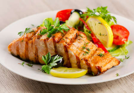 grilled salmon: Grilled Salmon with fresh salad and lemon. Selective focus Stock Photo