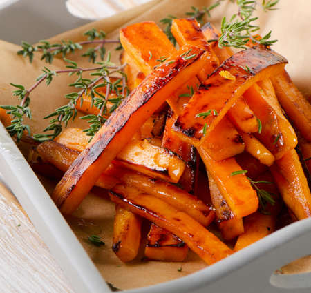 sweet: sweet potato fries with  thyme . Selective focus
