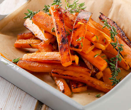 sweet potato fries with fresh herbs . Selective focus Stock Photo