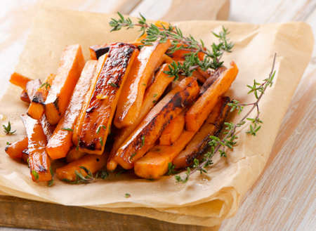 sweet foods: sweet potato fries on  wooden table . Selective focus