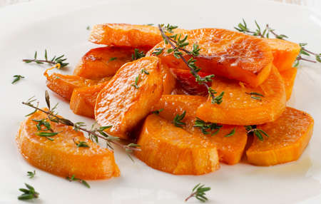 potato wedges: Baked sweet potato wedges on  white plate. Selective focus Stock Photo