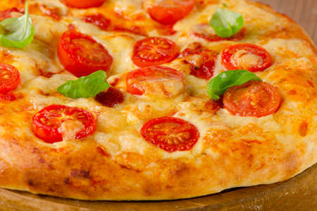 chees: italian pizza with tomatoes, chees and basil