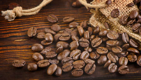 jamoke: Coffee beans  on a  wooden background. Selective focus Stock Photo