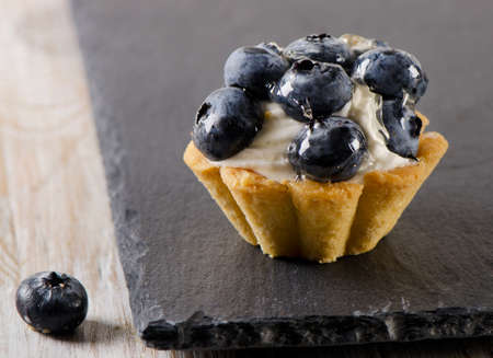 sweet tart: Sweet tart with fresh  blueberries. Selective focus Stock Photo