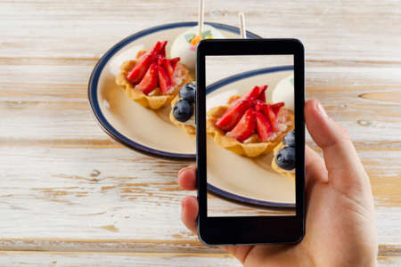 Smartphone shot food photo - dessert with fresh berries. Stock Photo