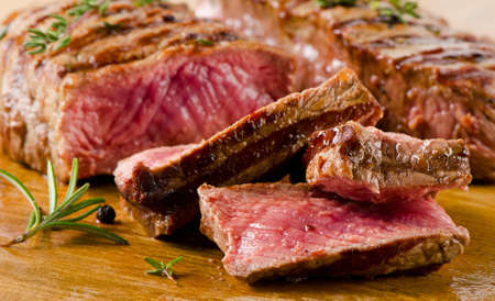 Beef  steak on    cutting board. Selective focus