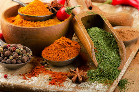 spice: Colorful  spices on spoons. Selective focus Stock Photo