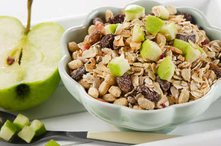 energizing: Healthy bowl of muesli, green apple for a nealthy breakfast Stock Photo