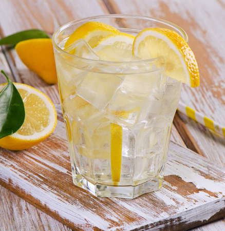 lemon: Glass of fresh water with a lemon. Selective focus Stock Photo