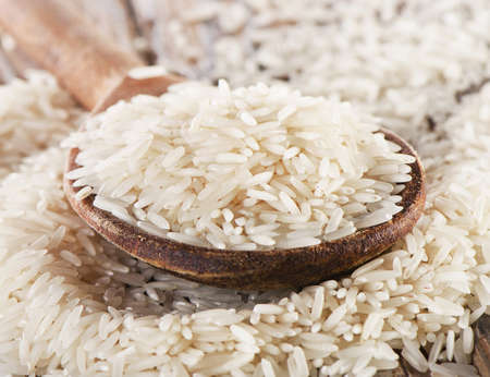 Basmati rice in  a wooden  spoon . Selective focus Stock Photo