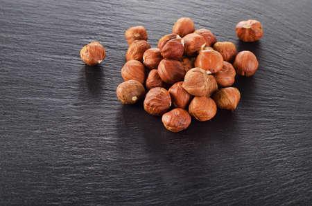 cobnut: Heap of hazelnuts on  dark background. Stock Photo