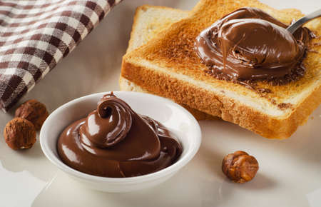 slices of bread: Fresh Toast with sweet chocolate spread for breakfast.