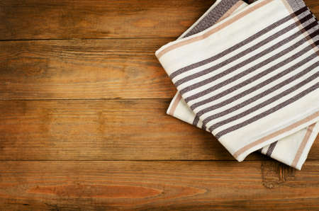 dishcloth: Tablecloth on  a old wooden  background.