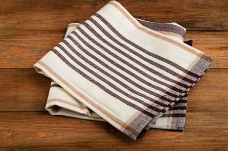 dishcloth: Tablecloth textile on  old wooden  background.