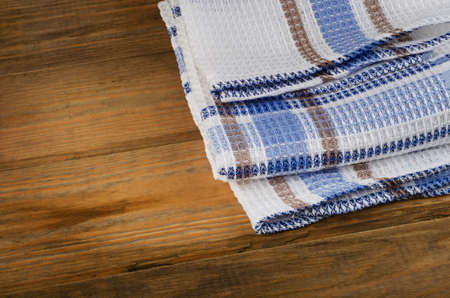 dishcloth: Tablecloth textile on a rustic wooden background. Stock Photo