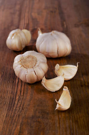 Organic garlic  on a wooden background. Selective focus photo