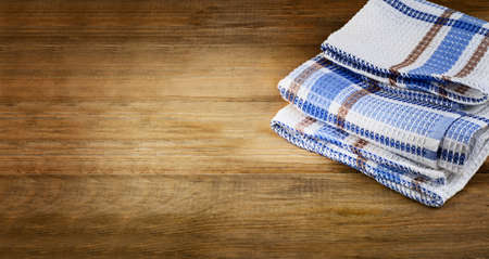 dishcloth: Tablecloth textile on old  rustic wooden background. Stock Photo