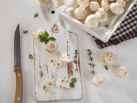 button mushrooms: Fresh white button mushrooms  on a wooden board. Overhead view