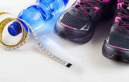 quench: Running shoes and bottle of water - healthy lifestyle