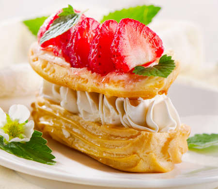 cream puff: Sweet cream puff with strawberries. Selective focus Stock Photo