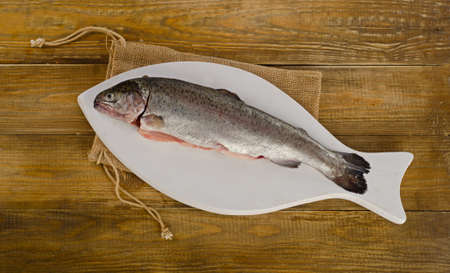salmon fishery: Rainbow trouts on a white cutting board. Top view