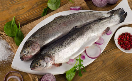 salmon fishery: Raw Rainbow trouts on  a  wooden table. Top view