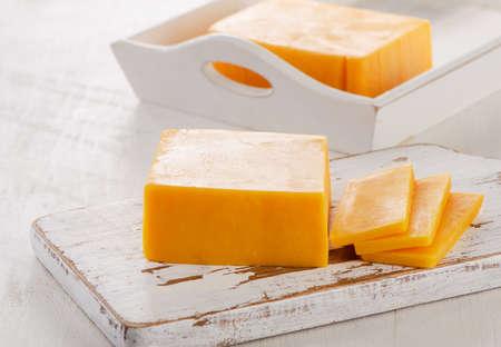 Cheddar Cheese on Cutting Board
