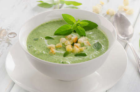 peas: Creamy vegetable soup with croutons. Selective focus Stock Photo