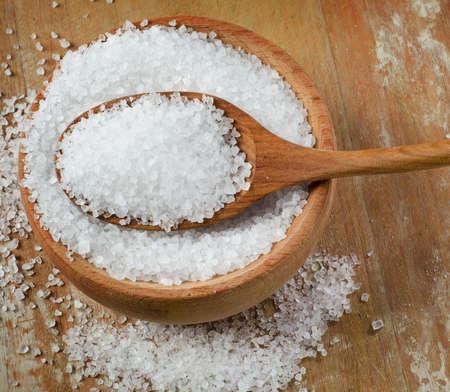 salt: Sea salt in wooden bowl. Selective focus