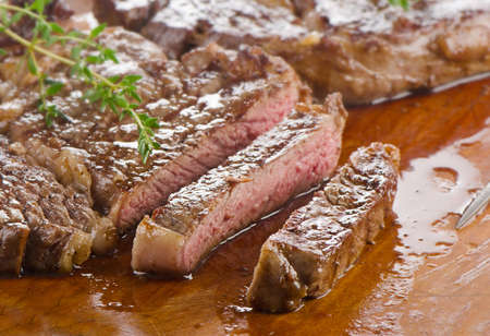 Beef steak on a wooden table. Selective focus