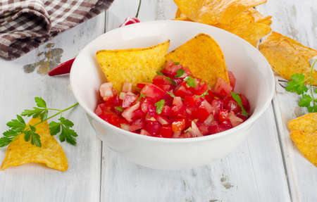 chips and salsa: Bowl of  salsa dip with chips. Selective focus