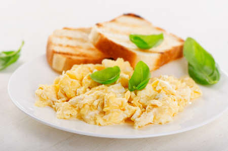 scramble: Healthy Breakfast with scrambled eggs and toasts. Selective focus