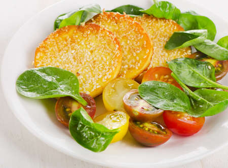 haloumi: Slices of halloumi cheese with vegetables. Selective focus Stock Photo