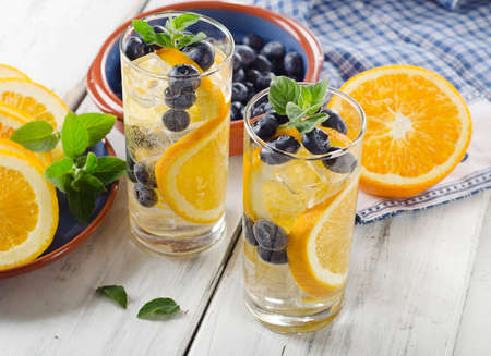 detox: Fresh Detox water with orange and berries. Selective focus Stock Photo