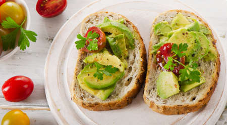 healthy meals: Homemade sandwiches with avocado and tomato. Selective focus